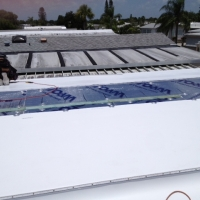 Single-Ply TPO Membrane Installation In Progress